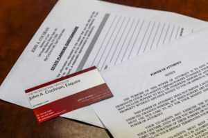 a photo of paperwork as a reminder you need a will
