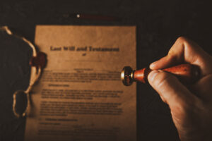 Image of a hand stamping a last will and testament.