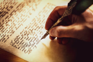 What makes a good guardian? An image of a person writing a will and estate with a quill pen.